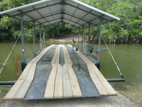 NEW HAND-CRANKED FERRY AT SUCCOTZ VILLAGE IN FAR WESTERN BELIZE--THE THIRD SUCH FERRY. LAST ONE GOT WORN OUT AFTER 20-SOMETHING YEARS; FIRST ONE GOT WIPED OUT BY HURRICANE HATTIE WHICH REACHED ALL THE WAY TO SUCCOTZ, 70-PLUS MILES INLAND.