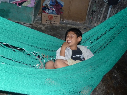 MOST EVERY BELIZEAN'S HOME WILL HAVE A HAMMOCK, OR TWO OR THREE INSIDE. AND ONE OR MORE OUTSIDE, TOO.