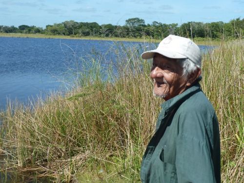 "Myrna's husband, ""Pa,"" at the lagoon in the cane fields."