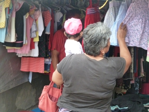 CLOTHES AT SATURDAY MARKET TOO; BUT THEN, EVERYTHING IMAGINABLE AT MARKET ON SATURDAY, INCLUDING SOME REALLY GOOD WINE FROM A RESORT. RAIN OR SHINE, SATURDAY MARKET IS HUGE IN SAN IGNACIO.