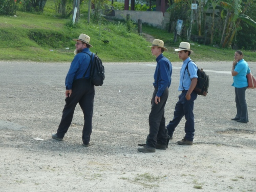 MENNONITE HOMEBOYS ON THE WESTERN HIGHWAY, WAITING FOR A BUS TO SAN IGNACIO. PROBABLY TO CLOSE ANOTHER LAND DEAL--THE MENNONITES ARE THRIFTY, MAKE A LOT OF MONEY AND PLOW IT BACK INTO THE LAND TO MAKE MORE MONEY PRODUCING FOOD (AND ICE CREAM) FOR ALL OF BELIZE.