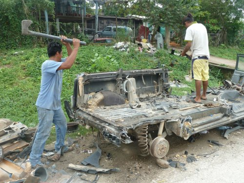Feel free to share your story of that vehicle from hell you always threatened to take a sledgehammer or, better yet, an axe to. In Belize they just act on that impulse and pile up the parts in the yard somewhere. Mi amigos here invited me to take a few wacks with the axe but I think I'll stick to wood chopping.