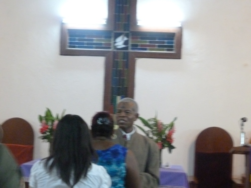 Pastor Angus at First Methodist Church in the capital city of Belmopan, Belize, making the sign of the ashes at the church's evening Ash Wednesday service I attended.