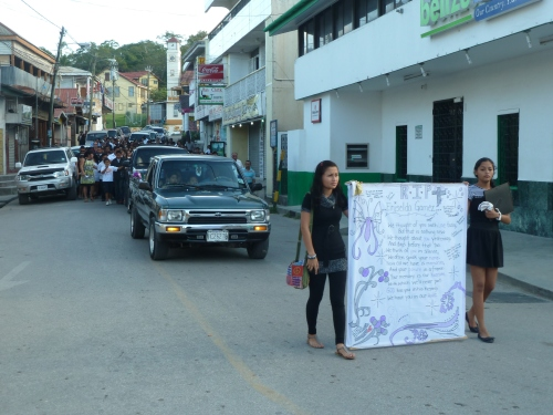 A funeral march to the cemetery in downtown San Ignacio, typical of the processions in neighboring countries  Mexico and Guatemala and so many others. Click on the pic to enlarge for a better look at the sign.