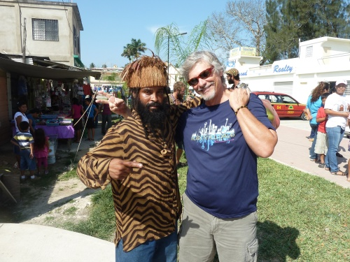 "This is my Rasmus/Marleyite buddy Razz J. You may recall that last time I saw him he was standing on his head down on the Mayawalk and I didn't recognize him even when he called out to me, ""What's up, Pastor Paul?"" He was wearing a tie for Mardi Gras and Marley Day observances and so I didn't snap to who it was right off. Saw him around market yesterday and he says, ""You getting big around the girth there, man; you need to get off the motorcycle and start walking more."" What I like about Razz, no nonsense. Keeps it real. Respect, Razz."