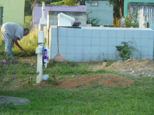 "Cleaning up the wife's grave with machete. ""I miss her every day,"" the gentleman told me. ""Keep her cleaned up."""