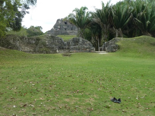 In foreground: Ancient Mayan Keens; best way to trod Xunantunich is barefoot. The grass feels good and the stone steps won't hurt you