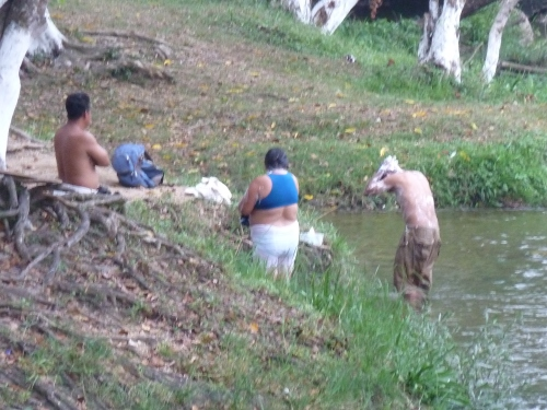 One sees a lot of washing the entire body in public  in the more shallow holy waters of Belize.