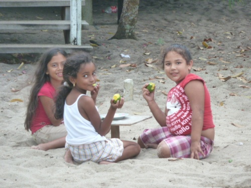 Snack time for the youngbloods in a backyard at Placencia the beach town.