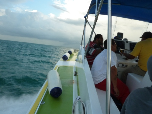 Sailing away for a stay on one of the scores of Belizean cayes (i.e., keys, islands). Wish you were here.