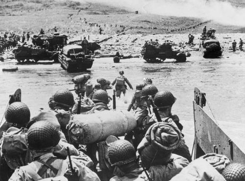 American soldiers and supplies arrive on the shore of the French coast of German-occupied Normandy during the Allied D-Day invasion on June 6, 1944 in World War II.   (AP Photo)