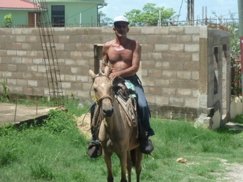 Did I mention all the horses and riders there are in Belize? If you like rural and rustic . . . come to the Wild West of Belize, as they call it.