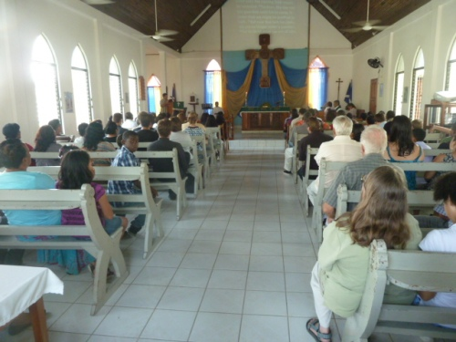 "Big crowd where I worshipped with those ""high church"" Anglicans in San Ignacio on a beautiful Sunday morning. St. Andrews typically has a lot of us American expats, tourists and visitors passing through town but mostly local and very faithful Belizeans. Many years ago, two of the elderly church-member women kept the church going without a rector. They are amazing church mothers, elderly lay Christians who refused to let this church die. It's now one of the most dynamic and vibrant churches in western Belize, operating one of the best schools in the West."