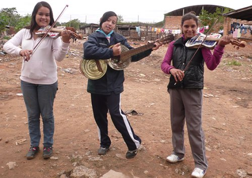 "Members of the ""Landfill Harmonic Orchestra"" live in extreme poverty in a slum on a landfill in Paraguay. But some of the kids are thriving as a result of resourceful garbage pickers making instruments from the stuff salvaged from the huge trash heap."