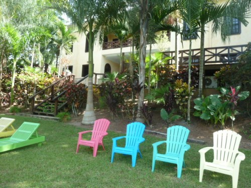 The terribly relaxing riverside lawn area at Mahogany Hall, below the little resort hotel and bar and restaurant and overlooking the Mopan.
