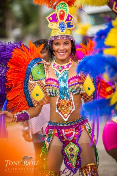 Photo by the great Belize-based photographer Tony Rath of a colorful beauty at the Carnival in Belize City  over the weekend here in Belize, where the month-long celebrations and events of September are building up to Saturday, the biggest Belizean holiday commemorating independence from the Brits on Sept. 21, 1981.
