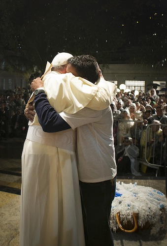 In this image from July, Pope Francis embraces a patient at St. Francis of Assisi Hospital in Rio De Janeiro. The pontiff addressed a group of recovering drug addicts, offering them a message of compassion and hope. (photo:CNS/L'Osservatore Romano).