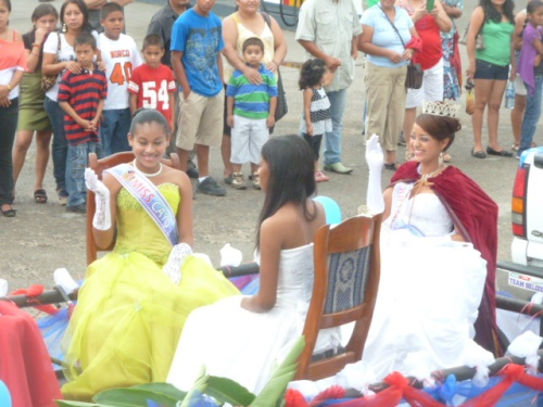 Pageants are huge in this part of the world and no celebration in Belize would be complete without the beauty queens. Shown on the right on this parade float, doing the obligatory queen wave, is the new Queen of the West Vanny Pat. She now has a shot at being the Queen of the Caribbean.