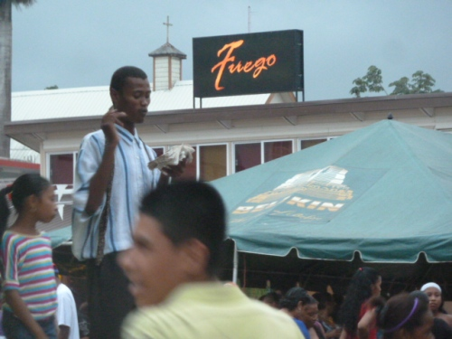 A young and fervent street preacher spent hours at the bus station calling on the revelers of Belize to repent of their sins. Don't think he won any souls over at the massive street party.