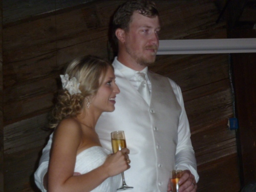 "My youngest-born ""baby"" Megan and her big Texan husband Jake. A large time was had in Texas at daughter's wedding where I choked up only once in officiating but was able to quickly recover and get them married. The outdoor wedding was under a perfectly blue October sky."