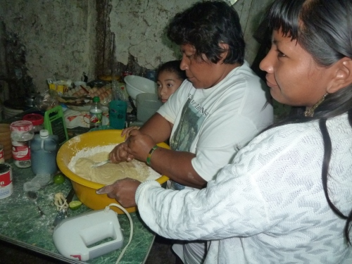 Myrna baking in her kitchen on Christmas night last year with her familia. The weather was clear and cool during that Christmas week in that norther BZ village of San Luis, near the Mexico border.  Last week the thatch roof over this kitchen caved in from rain. So goes life in Belize.