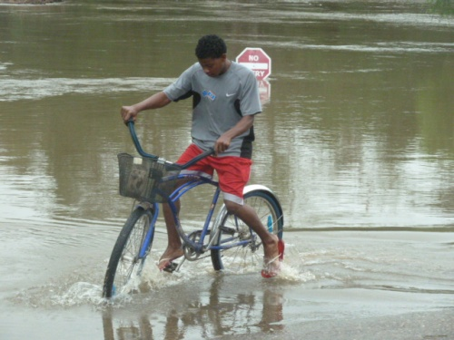 """The newly repaired """"low bridge"""" leading into the population and market center that is San Ignacio in Belize is under water, again."""