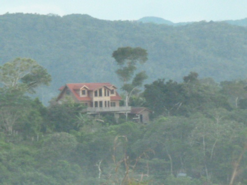 Many of the hills have big, sprawling homes like this one. Rich and poor live next door to each other in Belize.