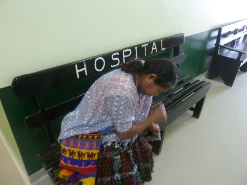 A Belizean waiting to see a doctor at quite third-worldish San Ignacio Hospital's outpatient clinic.