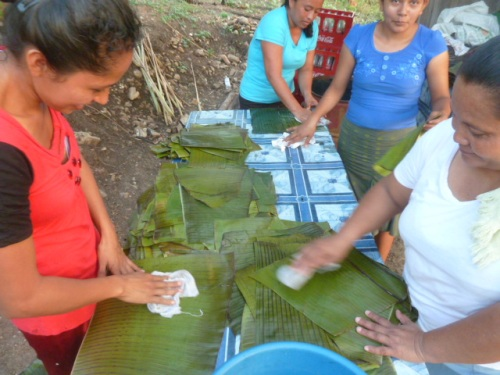 Village people, prepping plantain leaves for tamales.