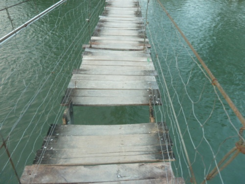 How do you get to the other side of the Mopan River on the swing bridge at Calla village? Holding your breath and praying helps.