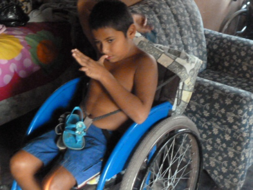 Antonio's 10-year-old son can't walk or talk, but loves to go swimming and caving in inner tubes. There's ancient water caves complete with Mayan bones and skulls and artifacts around less than a mile from Antonio's home.