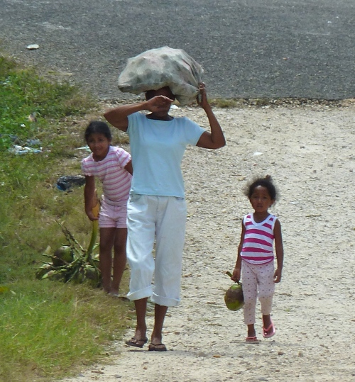 Belizeans walk miles and miles on rocky, dusty roads. The feet can get plenty dirty, as when Jesus walked.