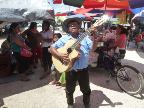 My friend finds happiness strolling around the market on Saturdays singing and making people happy with his music. He wants no money for it, just wants the happiness it brings him and others.