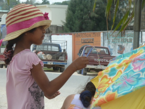 Meanwhile, back in town on a hot Saturday: a funky, spunky Belizean girl at the market. Thought the hat was a great look.