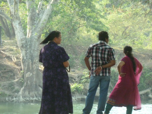A Belizean Mennonite with a Belizean Hindu couple: Belize has a high number of Mennonites and Middle Easterners, most of whom are Hindu.  And then there's all the Chinese who are a significant part of BZ's very diverse population (Pop. 300,000).