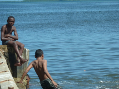 Kids cooling down in Belize City. .