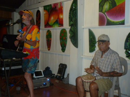 "Ed lost his dreadlocks to brain surgery, but hasn't lost his mojo on de drum. Here he is playing a Jimmy Buffet coconut song with the colorful western Belize musician ""Barefoot Skinny."" He and Ed played in a band together years ago doing regular gigs at the Orange Gallery.--"
