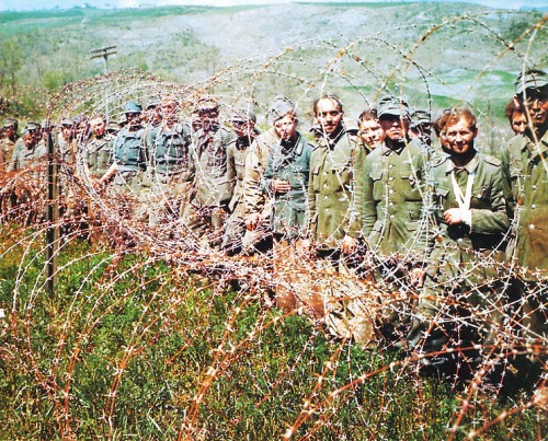 German Prisoners of War are kept behind barbed wire in Normandy, France in June of 1944. More than 200,000 German soldiers were captured during the Battle of Normandy.  (Photo by Galerie Bilderwelt/Getty Images)