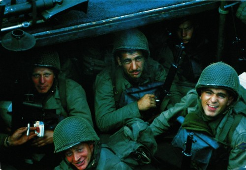 United States Rangers from E Company, 5th Ranger Battalion, on board a landing craft assault vessel (LCA) in Weymouth harbor, Dorset, on June 4, 1944. The ship is bound for the D-Day landing on Omaha Beach in Normandy. Clockwise, from far left: First Sergeant Sandy Martin, who was killed during the landing, Technician Fifth Grade Joseph Markovich, Corporal John Loshiavo and Private First Class Frank E. Lockwood. They are holding a 60mm mortar, a Bazooka, a Garand rifle and a pack of Lucky Strike cigarettes.  (Photo by Galerie Bilderwelt/Getty Images)