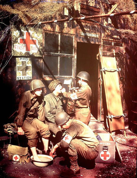 U.S. Army Medics treating two GIs at a first aid post in southern England in 1944. The soldiers are among the troops due to embark for the invasion of Normandy.  (Photo by Galerie Bilderwelt/Getty Images)