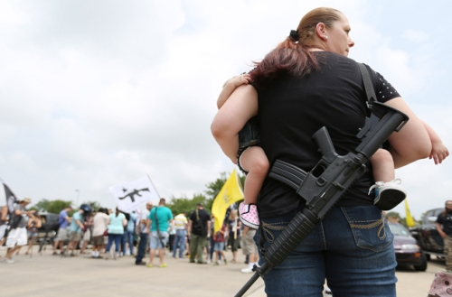 The NRA has gone librul on these people packing assault rifles. Where is Joe the Plumber when you need him.