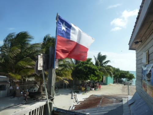 "The best beach bar in Belize, bar none, is the bar down at ""The Split,"" where the owner flies what looks so much like the wonderful flag of Texas Our Texas (All hale the might-teee state! I thought it was my beloved Lone Star State flag myself the first time I ever saw it here, and bowed down in reverence. (Nobody paid any attention; eccentric behavior at Caye Caulker is the norm) I realized as I was leaving that day that it's in fact the very similar flag of Chile. The owner is from there, not, sadly for him, from Texas!"