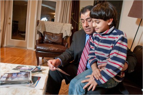 In this New York Times photo by Steve Payne: Palestinian Dr.Izzeldin Abuelaish, with his son Abdallah, looking at a photo of Bessan, one of the doctor's three daughters killed by an Israeli bomb in 2009. His story of faith and forgiveness is remarkable.