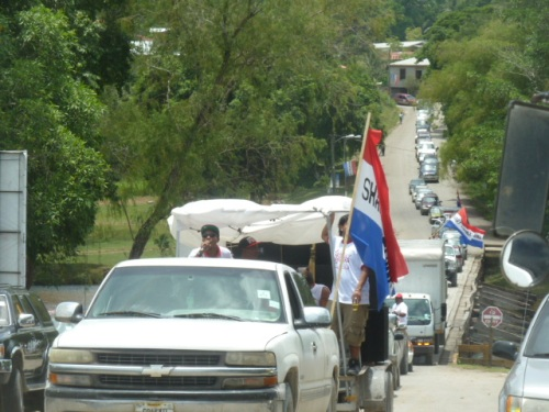 "Shary Medina's big campaign parade entering town at the ""low bridge"" entrance into town. He male opponent ran a low-key campaign and won largely because of his 17 years on the town council and his longtime record of buy votes. In Belize, if you need a new roof, some concrete and dirt to build a house on your property--whatever, your elected leaders are there for you at election time. I got a new paved street to replace one of the worst streets in town during an election last year, because people threatened to vote for the incumbent's opponent."