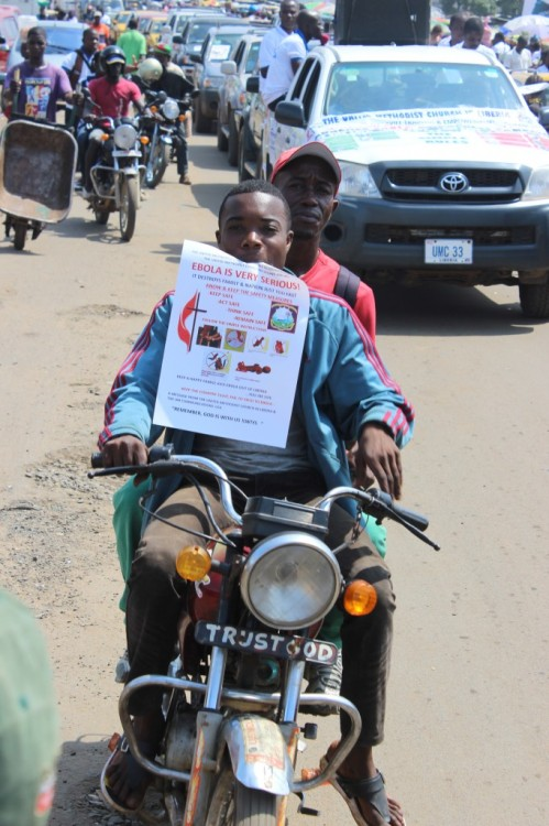 Methodists in Liberia passing out information flyers as part of an Ebola education program sponsored by the Methodist Church of Liberia and United Methodist Communications USA