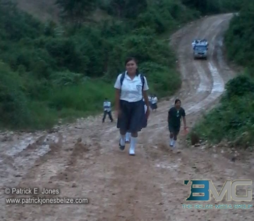 Kids in far southern Belize, where there are massive amounts of rain, trudge miles through the wet routes to school.