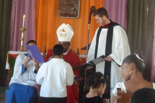 One of 18 young confirmands receives a blessing from Belize's Anglican Bishop Philip Wright of Belize City, at St. Andrew's Anglican Church here in San Ignacio in western Belize. Standing is my dear young friend and gifted rector at St. Andrew's Anglican Church Father David, a native of Indiana.