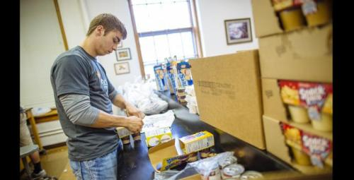 Dakota Wesleyan University senior Brent Matter volunteers for the Weekend Snack Pack Program to provide easy-to-prepare meals to help children who primarily stay home alone on the weekends have something nutritious to eat.