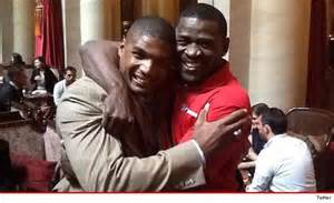Football legend Michael Irvin with Michael Sam, who was the first, openly gay player in a brief pro football career.