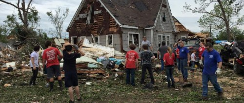 United Methodist church volunteers cleaning up in the heat and mess of storms and a tornado in Van, Tx. in a scene that has played out in places all over Texas and the Southeast lately.